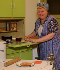 Living history interpreter as Mrs Lockwood in the miner's kitchen