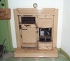 Go to the page that contains this image: Kitchen range, a coal-fired fireplace which included an oven and a hob