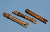 Go to the page that contains this image: Clothes pegs, of a type usually made by travelling people